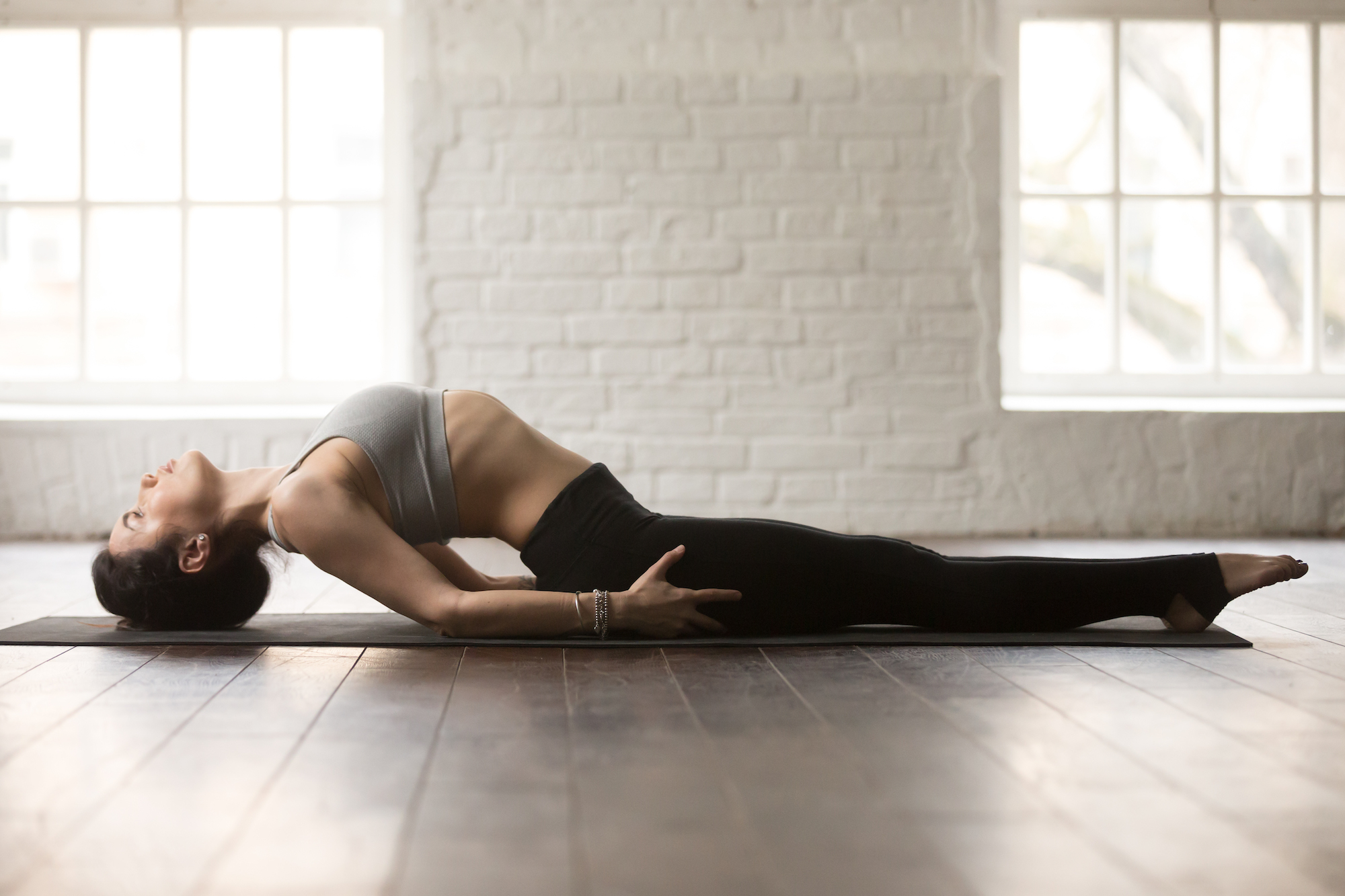 woman stretching yoga position